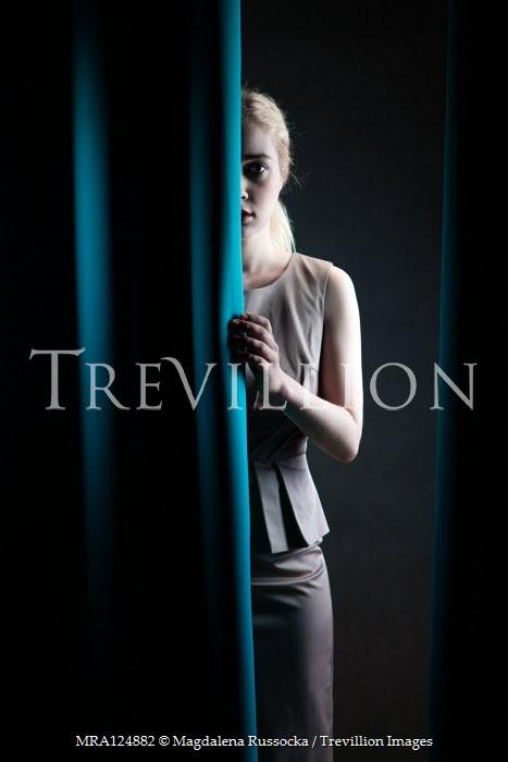 Magdalena Russocka elegant woman behind curtains