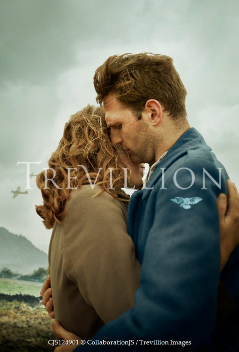 CollaborationJS WARTIME COUPLE EMBRACING OUTDOORS WITH AEROPLANES Couples