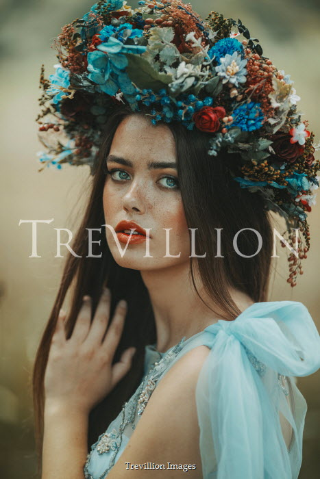 Jovana Rikalo WOMAN IN TURQUOISE GOWN AND FLORAL HEADDRESS Women
