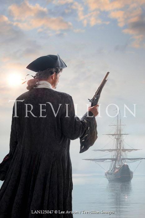 Lee Avison 17th century Georgian pirate awaiting a Galleon sailing ship with a flintlock pistol