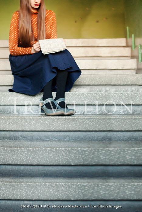 Svetoslava Madarova GIRL SITTING ON STEPS READING LETTER Women