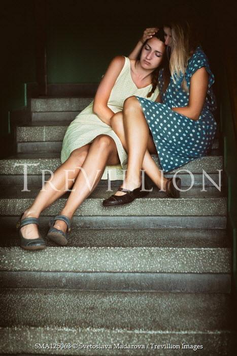 Svetoslava Madarova TWO WOMEN SITTING ON CONCRETE STEPS Women