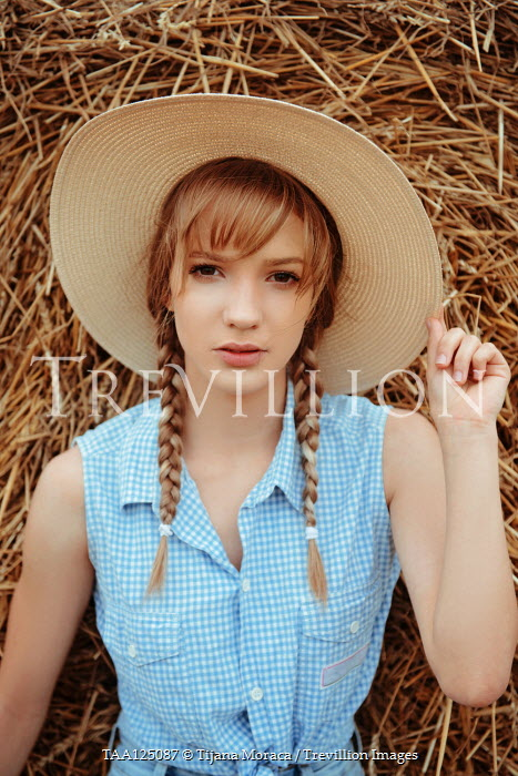 Tijana Moraca GIRL WITH PLAITS AND STRAW HAT BY HAY BALE Women