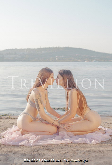 Inna Mosina TWO GIRLS IN BIKINIS KNEELING ON BEACH Women