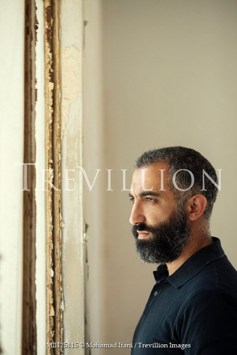 Mohamad Itani MAN WITH BEARD IN SHABBY ROOM BY WINDOW Men