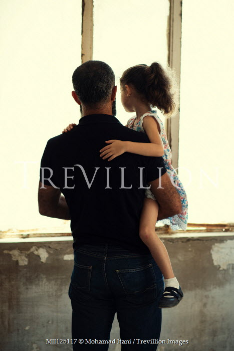 Mohamad Itani FATHER HOLDING DAUGHTER WATCHING AT WINDOW Children