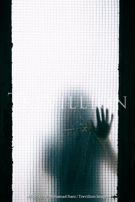 Mohamad Itani SHADOW OF WOMAN TOUCHING BROKEN WINDOW Women
