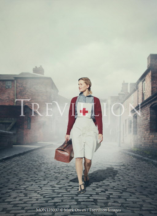 Mark Owen NURSE CARRYING LEATHER CASE ON COBBED STREET Women