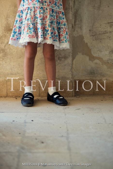 Mohamad Itani LITTLE GIRL IN PATTERNED DRESS IN SHABBY BUILDING Children