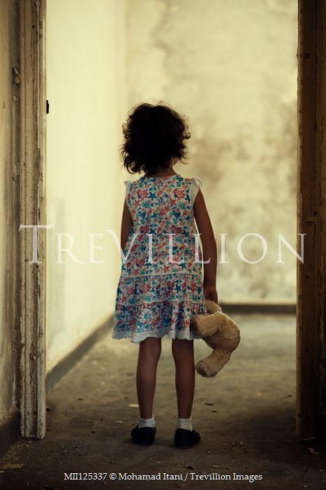 Mohamad Itani LITTLE GIRL CARRYING TEDDY IN SHABBY BUILDING Children