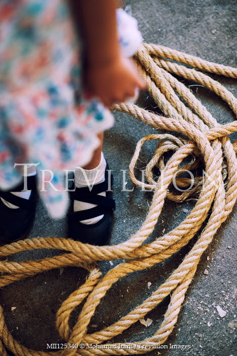 Mohamad Itani LITTLE GIRL WITH ROPE BY FEET Children