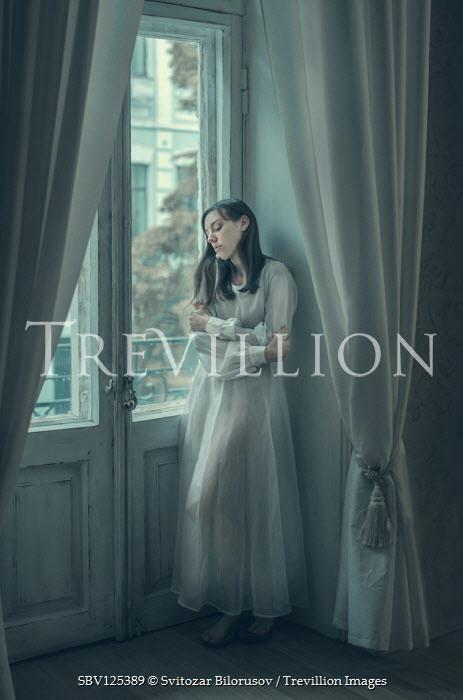 Svitozar Bilorusov GIRL IN WHITE STANDING BY GLASS DOORS Women
