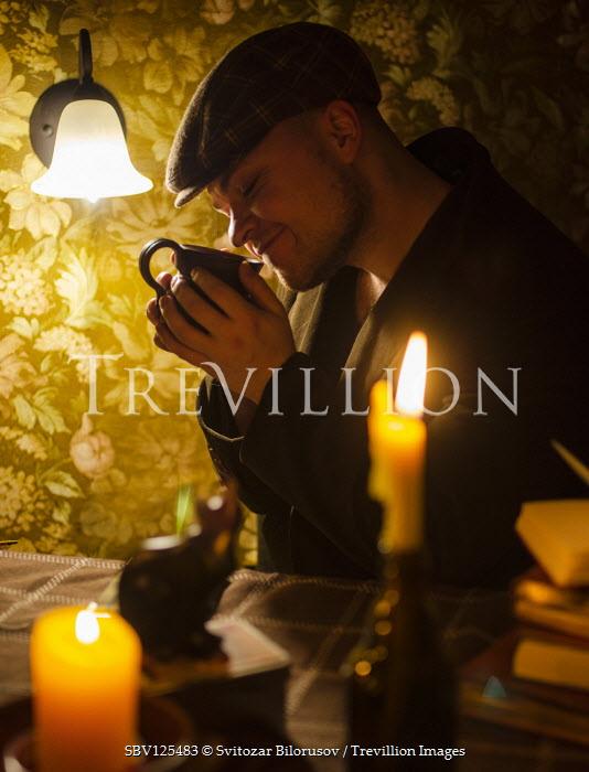 Svitozar Bilorusov MAN SMELLING COFFEE INDOORS WITH CANDLES Men