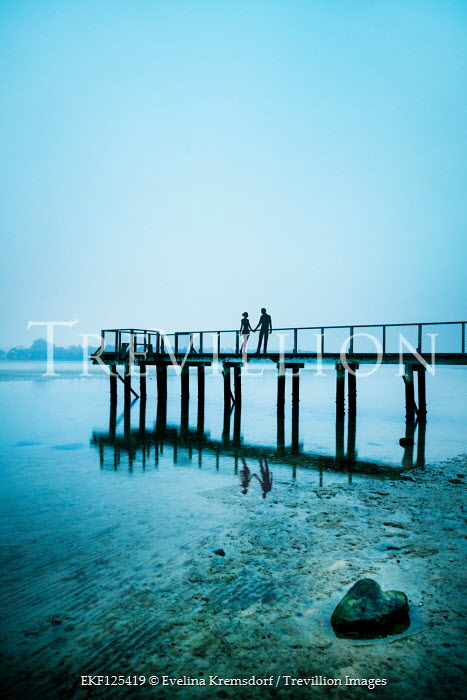 Evelina Kremsdorf COUPLE HOLDING HANDS ON JETTY BY LAKE Couples