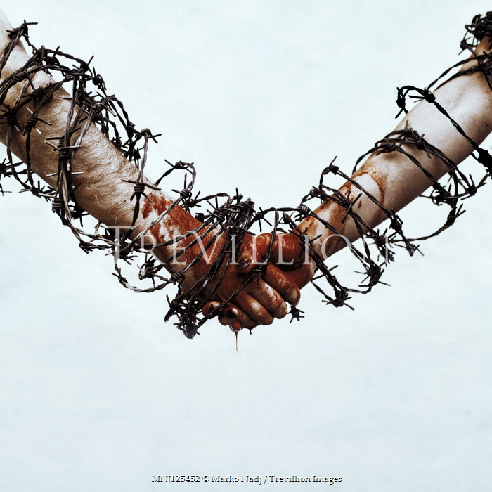 Marko Nadj COUPLE HOLDING BLEEDING HANDS COVERED WITH BARBED WIRE Couples