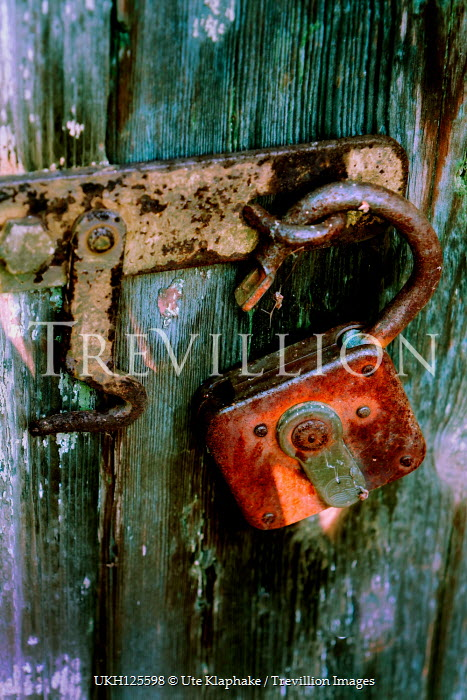 Ute Klaphake UNLOCKED RUSTY PADLOCK ON WEATHERED DOOR Miscellaneous Objects