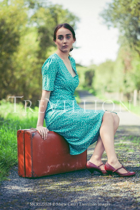 Marie Carr GIRL SITTING ON SUITCASE IN COUNTRY LANE Women