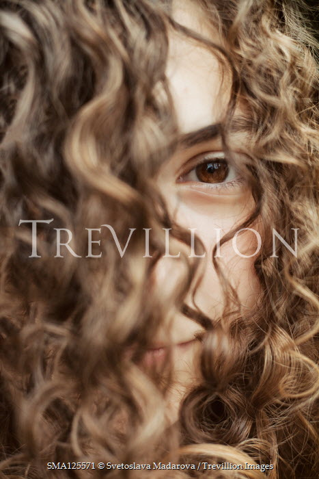 Svetoslava Madarova FACE OF LITTLE GIRL COVERED WITH BROWN CURLY HAIR Children