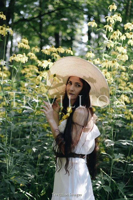 Alina Zhidovinova WOMAN WITH HAT IN GARDEN WITH TALL FLOWERS Women