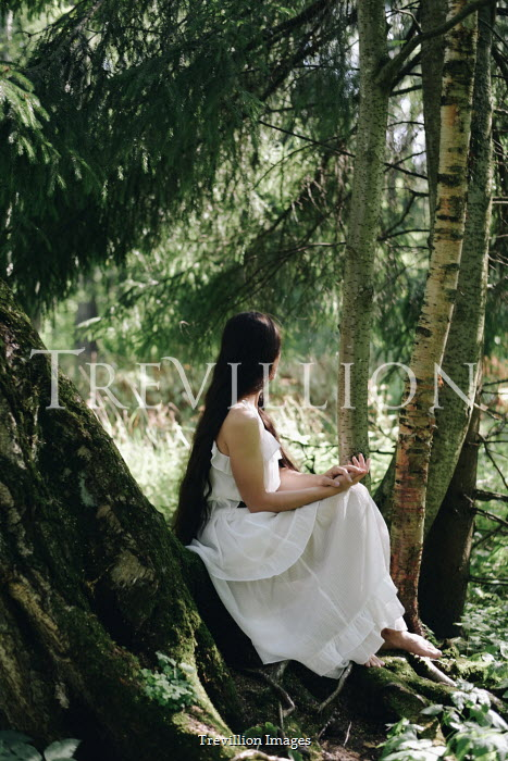 Alina Zhidovinova WOMAN IN WHITE SITTING BY TREE IN COUNTRYSIDE Women