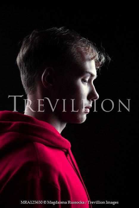 Magdalena Russocka teenage boy in red hoodie inside