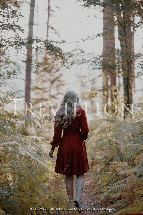 Rekha Garton BLONDE WOMAN WALKING ON FOREST PATH Women