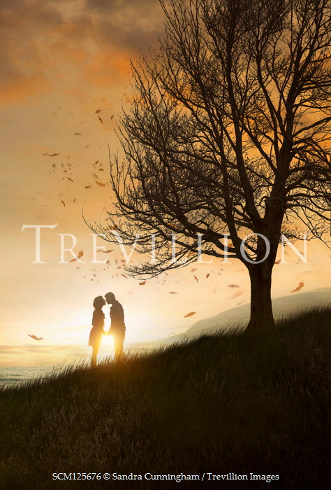 Sandra Cunningham SILHOUETTED COUPLE KISSING BY TREE AND SEA Couples