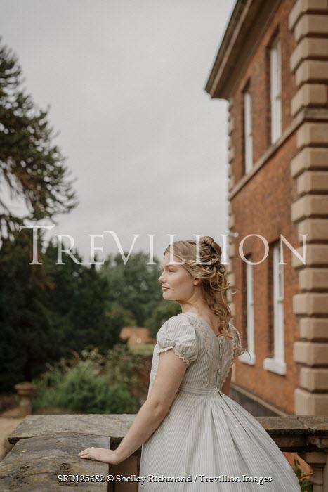 Shelley Richmond BLONDE REGENCY WOMAN ON BALCONY OF GRAND HOUSE Women