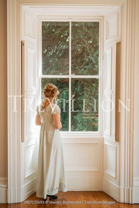 Shelley Richmond BLONDE REGENCY WOMAN STANDING INDOORS BY WINDOW Women