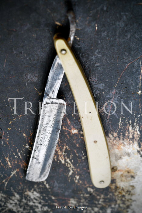 Adrian Muttitt CUT THROAT RAZOR ON SCRATCHED TABLE Miscellaneous Objects