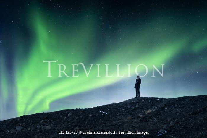 Evelina Kremsdorf MAN STANDING ON HILL WITH LIGHTS IN SKY Men