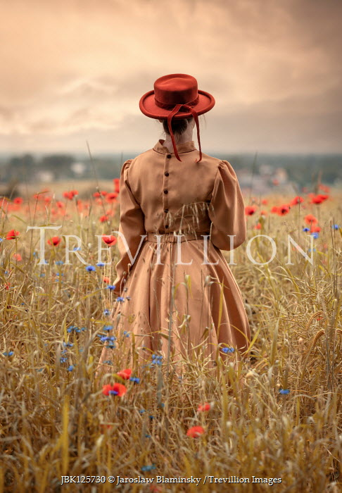 Jaroslaw Blaminsky WOMAN IN HAT STANDING IN POPPY FIELD Women