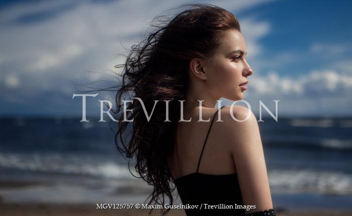 Maxim Guselnikov BRUNETTE GIRL IN PROFILE ON WINDY BEACH Women