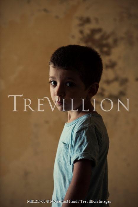 Mohamad Itani SAD LITTLE BOY IN SHABBY ROOM Children