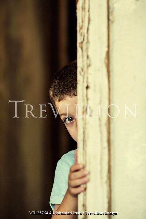 Mohamad Itani LITTLE BOY PEEPING BEHIND DOORWAY Children