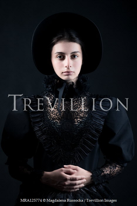 Magdalena Russocka victorian woman in black wearing bonnet