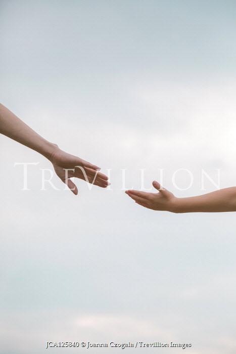 Joanna Czogala MOTHER'S HAND REACHING FOR DAUGHTER'S OUTSIDE Children