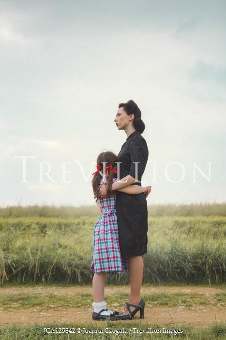 Joanna Czogala WOMAN HUGGING LITTLE GIRL IN COUNTRYSIDE Children