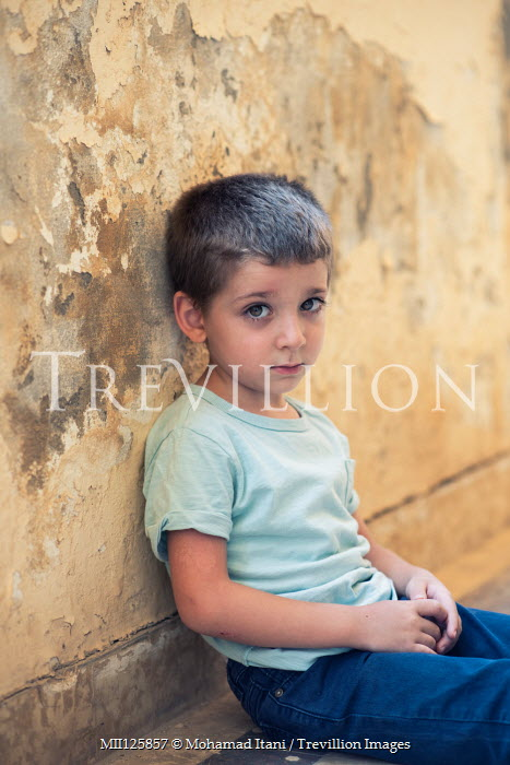 Mohamad Itani SAD LITTLE BOY SITTING IN SHABBY ROOM Children
