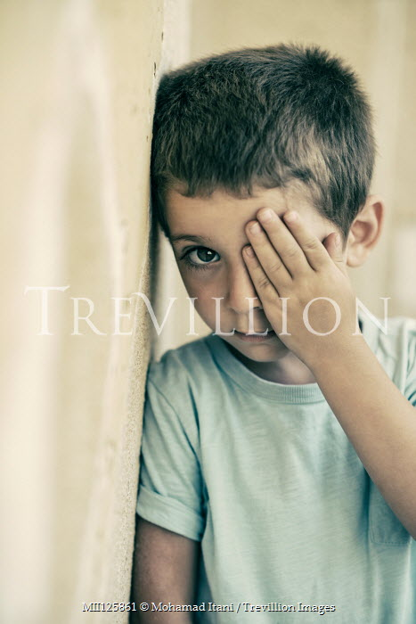 Mohamad Itani SAD LITTLE BOY COVERING EYE WITH HAND Children