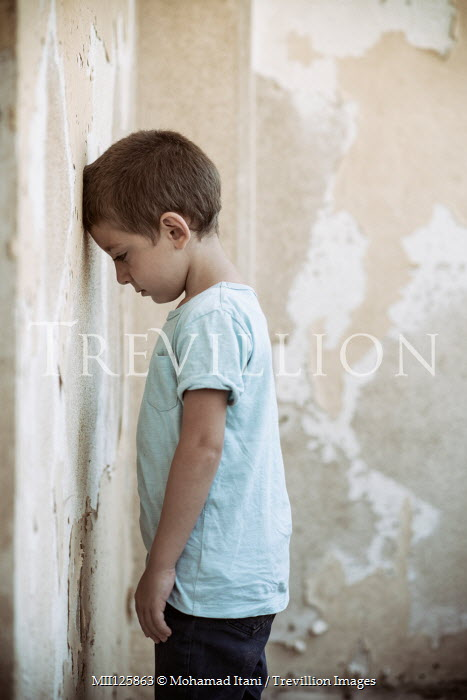 Mohamad Itani SAD LITTLE BOY FACING WALL IN SHABBY ROOM Children