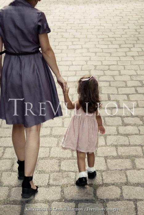 Kerstin Marinov MOTHER AND DAUGHTER WALKING HOLDING HANDS OUTDOORS Children