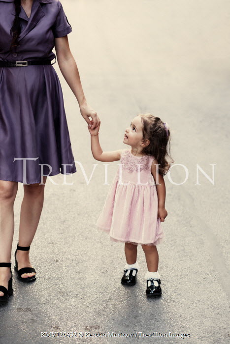 Kerstin Marinov MOTHER AND DAUGHTER WALKING HOLDING HANDS OUTDOORS Children
