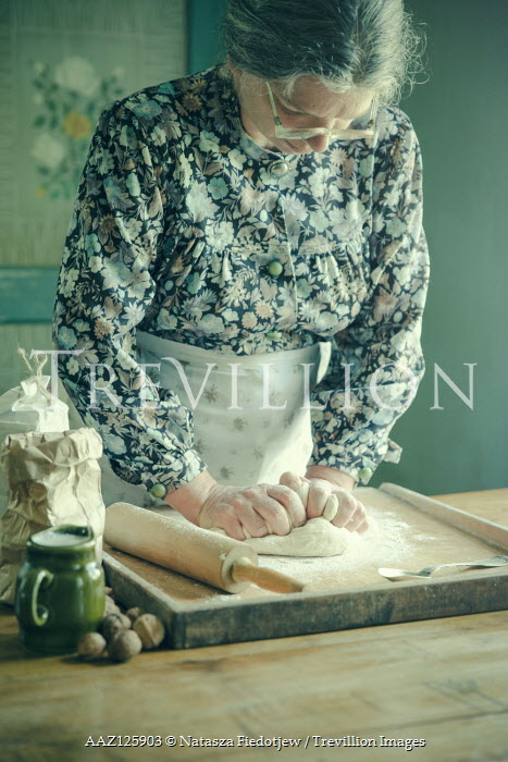 Natasza Fiedotjew ELDERLY WOMAN ROLLING PASTRY IN KITCHEN Old People