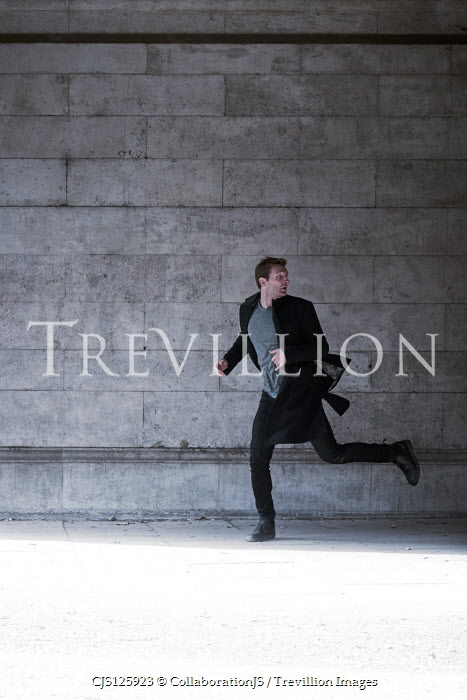 CollaborationJS MAN RUNNING IN STONE PASSAGEWAY Men