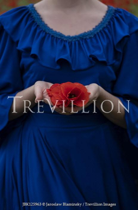 Jaroslaw Blaminsky WOMAN IN BLUE DRESS HOLDING RED FLOWER Women