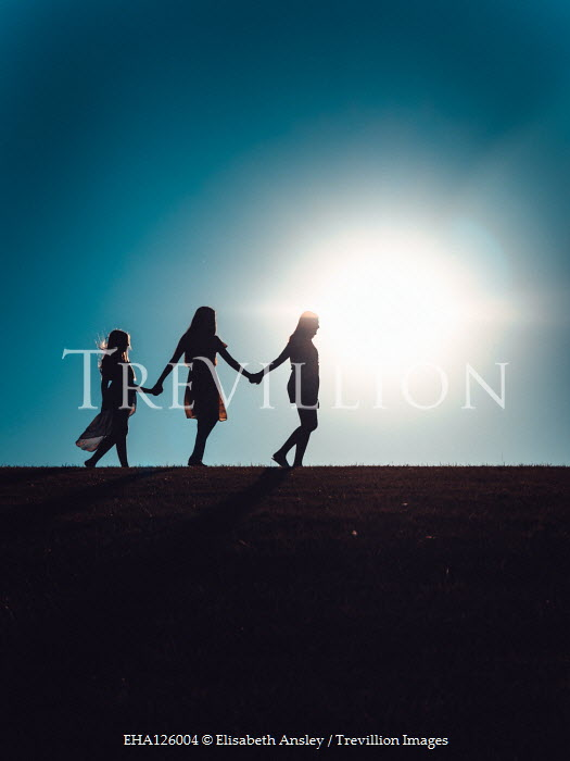 Elisabeth Ansley THREE SILHOUETTED FEMALES HOLDING HANDS Groups/Crowds