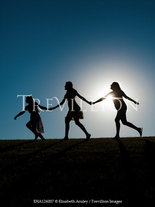 Elisabeth Ansley THREE SILHOUETTED FEMALES HOLDING HANDS IN FIELD Groups/Crowds