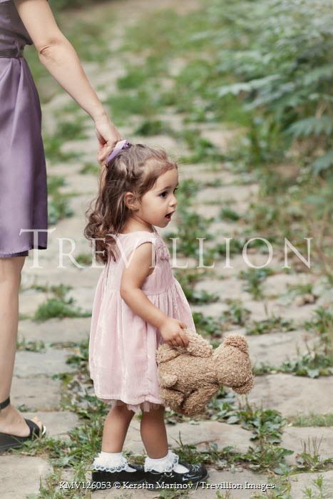 Kerstin Marinov LITTLE GIRL CARRYING TEDDY HOLDING HANDS WITH MOTHER Children