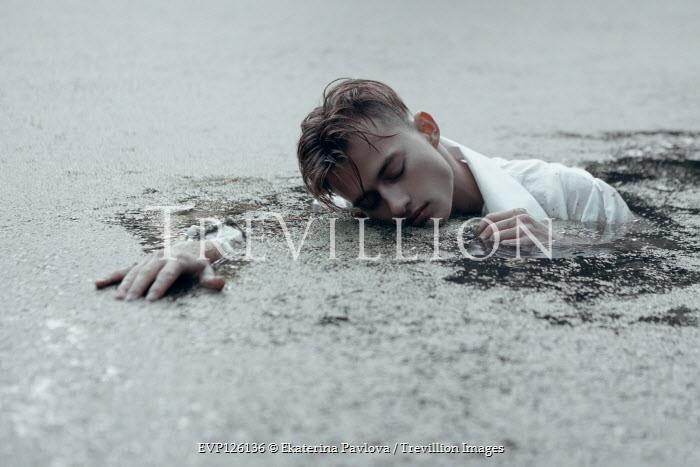 Ekaterina Pavlova MAN FLOATING IN POND WITH WEEDS Men